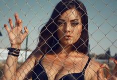 Beautiful girl with dark hair stock photos