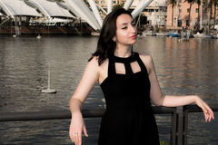 Beautiful girl with dark hair and a black dress Royalty Free Stock Photo