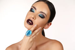 Beautiful girl with dark hair with bright extravagant makeup and bijou Royalty Free Stock Images