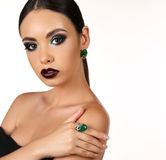 Beautiful girl with dark hair with bright extravagant makeup and bijou Royalty Free Stock Photos
