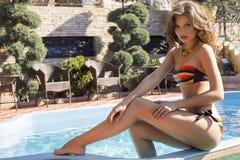 Beautiful girl with dark hair in colorful bikini Stock Images