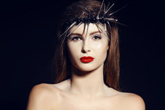 Beautiful girl with dark hair with evening makeup and luxurious crown on head Royalty Free Stock Image
