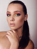 Beautiful girl with dark hair and extravagant bright makeup Stock Photo