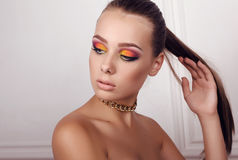 Beautiful girl with dark hair and extravagant bright makeup Royalty Free Stock Photo