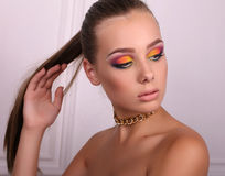 Beautiful girl with dark hair and extravagant bright makeup Royalty Free Stock Photos