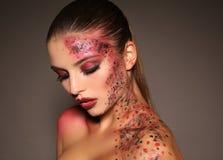 Beautiful girl with dark hair with extravagant Halloween makeup Stock Photos