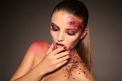 Beautiful girl with dark hair with extravagant Halloween makeup Royalty Free Stock Photography
