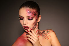 Beautiful girl with dark hair with extravagant Halloween makeup Royalty Free Stock Images
