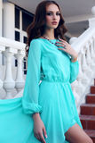 Beautiful girl with dark hair in luxurious blue dress posing on stairs. Fashion outdoor photo of beautiful sensual girl with dark hair in luxurious blue dress stock photo