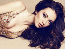 Beautiful girl with dark hair in luxurious sequin dress Stock Images