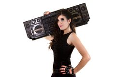 Beautiful girl in dark leather clothes holding a large retro radio Royalty Free Stock Photography