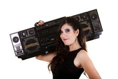 Beautiful girl in dark leather clothes holding a large retro radio Royalty Free Stock Photos