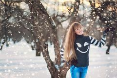 Beautiful girl in a beautiful day winter snow park Stock Photo
