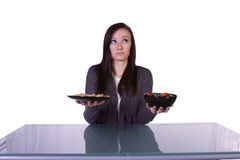 Beautiful Girl Deciding What to Eat Royalty Free Stock Image