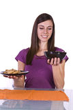 Beautiful Girl Deciding What to Eat. Beautiful Girl Watching her Weight Deciding to Eat Salad or Cookies Stock Image