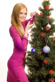 Beautiful girl decorating christmas tree Royalty Free Stock Images