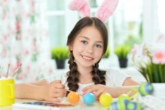 Beautiful Girl Decorating Eggs For Easter Holiday Royalty Free Stock Images
