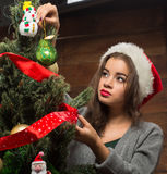 Beautiful girl decorating New Year tree at home Royalty Free Stock Images