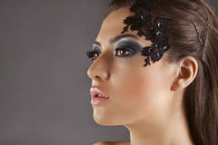 Beautiful girl with decoration on the face, in profile Stock Images