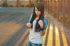 Beautiful girl in a denim jacket in the sunlight sunset. Outdoor Royalty Free Stock Image
