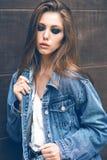Beautiful brunette on the street Stock Image