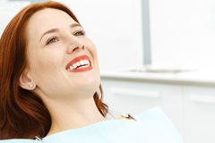 Beautiful girl on the dental chair. Waiting for dentist Royalty Free Stock Image