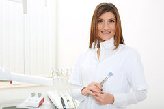 Beautiful girl dentist with mirror and dental probe Royalty Free Stock Photography