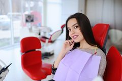 Beautiful girl in the dentist`s chair royalty free stock image