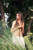 Beautiful girl on a desert island. Beautiful girl among the trees on a deserted island Royalty Free Stock Images