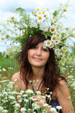 Beautiful girl in diadem of wildflowers Stock Photos