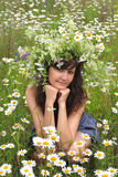Beautiful girl in diadem of wildflowers Stock Photo