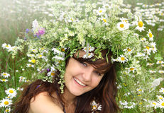 Beautiful girl in diadem of wildflowers Royalty Free Stock Photography