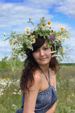 Beautiful girl in diadem of wildflowers Stock Photography