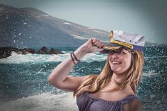 Cheerful happy girl with marine cap on the sparkling sea Royalty Free Stock Image