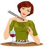 Beautiful girl dines. Beautiful girl eats a Greek salad and drinking red wine Stock Image