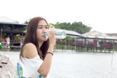 Beautiful girl dinking water Royalty Free Stock Photography