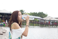 Beautiful girl dinking water Royalty Free Stock Images