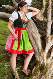 Beautiful girl in a dirndl dreams to himself Stock Photos