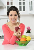 Beautiful girl with dish of fruits Royalty Free Stock Photo