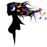 The beautiful girl with dispelled hair and butterflies Stock Image