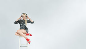 Beautiful alluring girl DJ with hadphones Royalty Free Stock Photography