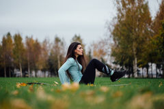Beautiful girl does exercises with press at the grass Stock Photo