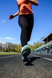 Beautiful girl does jogging in spring. Athletic girl goes in for sports in the open air Stock Photo