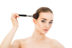 Beautiful girl does make-up with brush isolated. Beautiful girl does make-up with brush Royalty Free Stock Photos