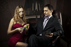 Beautiful girl does a manicure rich man. Beautiful girl does a manicure rich men in a suit royalty free stock photos