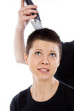 The beautiful girl does not wish to be haircut Stock Images