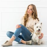 Beautiful girl with dog Stock Photography