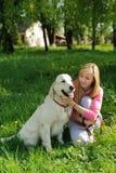 Beautiful girl and dog Royalty Free Stock Photo