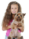 Beautiful girl with a dog in her arms. Royalty Free Stock Image