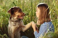 Beautiful girl with dog Stock Photo